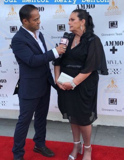 Kerrie on the red carpet for the Mister Supranational USA 2018 pageant being interviewed by Tyrone Tann for Stauros Entertainment TV.